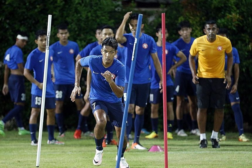 Garena Young Lions forward Fareez Farhan, foreground, who has scored all of his side's goals so far, is looking forward to the return of captain Khairul Amri to spearhead their attack in the rest of this S-League season.