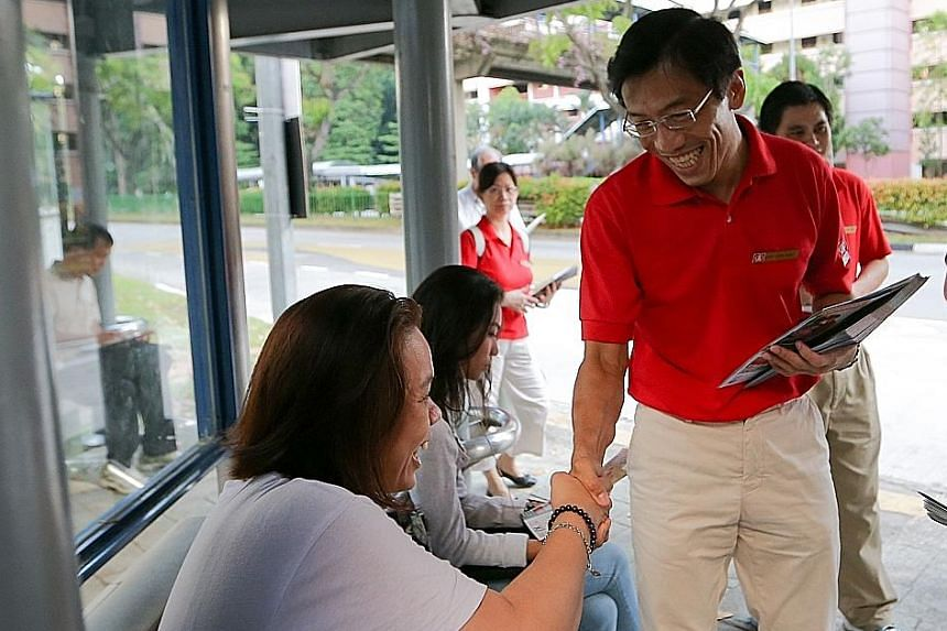 Dr Chee on his walkabout in Bukit Batok yesterday. This is his pitch to residents: Vote him into Parliament and he will hold the Government to account.
