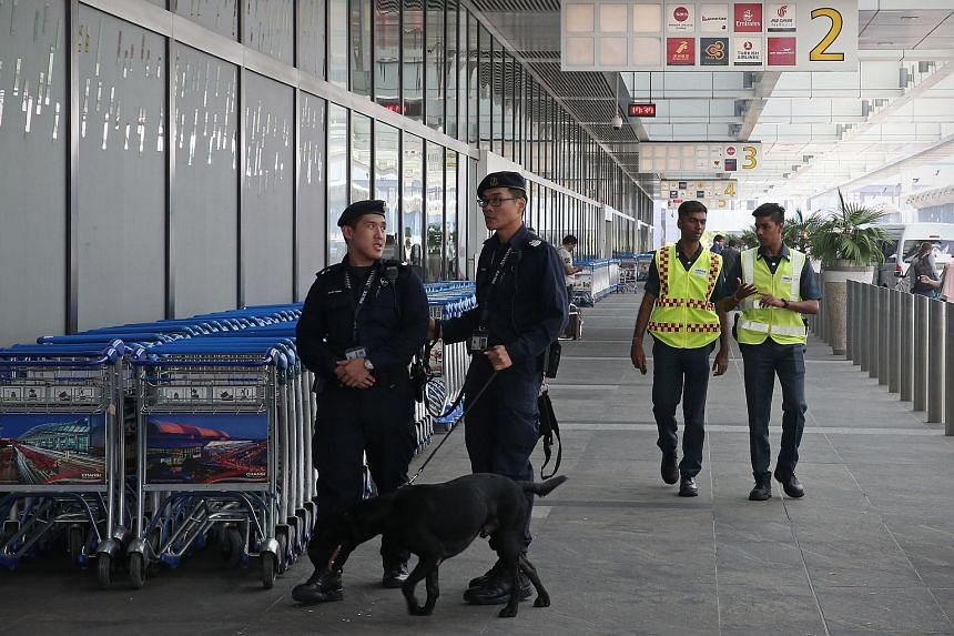 Security personnel patrolling Changi Airport Terminal 1.