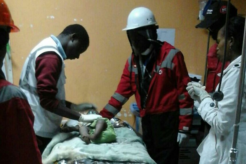 Medical staff treat a baby girl rescued from a collapsed building in Nairobi, Kenya, on May 3, 2016.