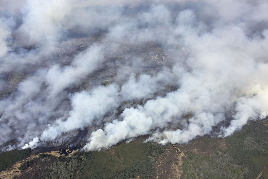 An aerial view from the helicopter of Alberta Premier Rachel Notley shows smoke rising from raging wildfires which caused the mandatory evacuation of Fort McMurray.