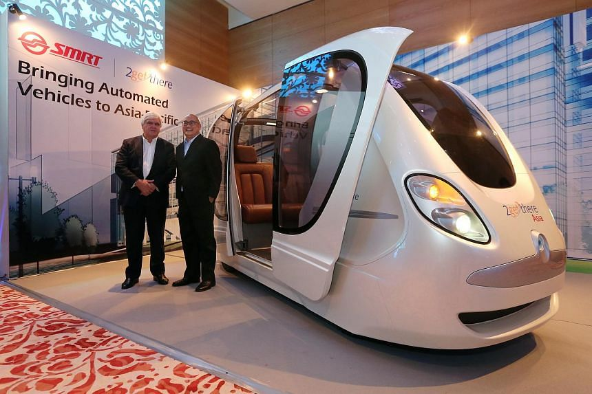 Mr Carel van Helsdingen (left), chairman and founder of 2 Getthere Holding B. V. (2gettehere) and Mr Colin Lim, managing director of SMRT Services, unveiled a replica of the PRT at a media conference held on April 20.
