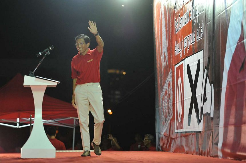 Dr Chee Soon Juan arriving on stage to speak at the SDP rally at the field along Bukit Batok Industrial Park A on May 03, 2016.