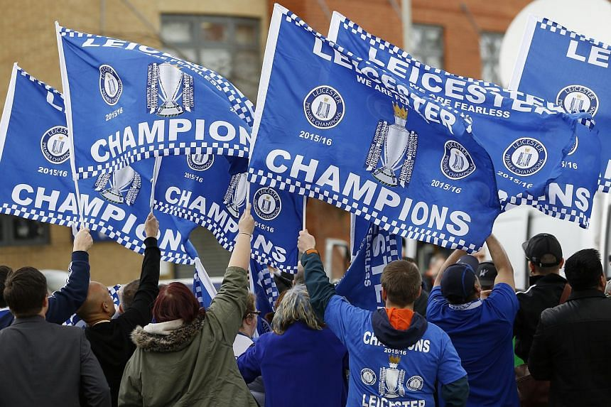 Leicester City fans celebrate winning the English Premier League.