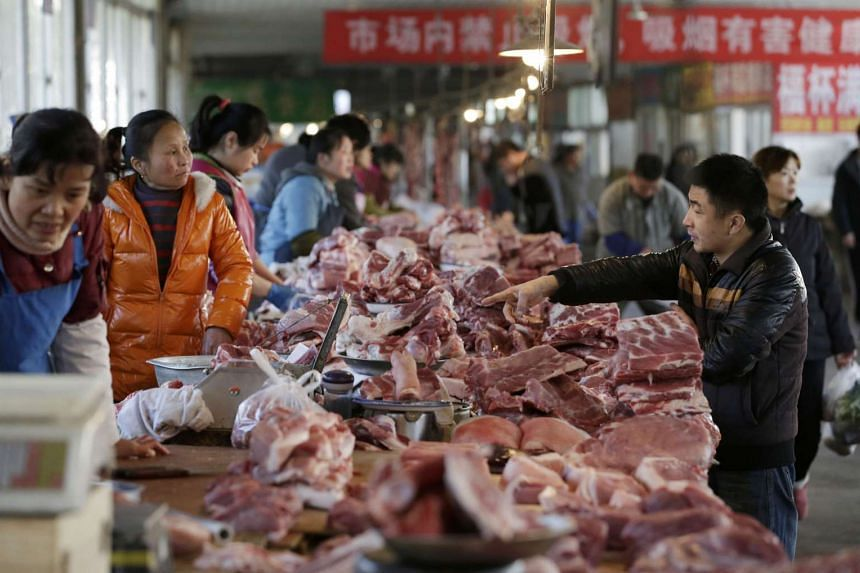 Meat stalls are seen at a market in Beijing.