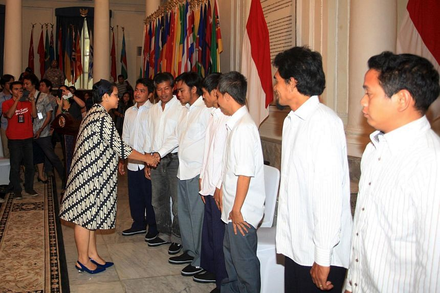 Indonesian Foreign Minister Retno Marsudi (left) shakes hands with Indonesian hostages released by Islamist militants in the Philippines at the Foreign Ministry office in Jakarta, Indonesia, on May 2, 2016.