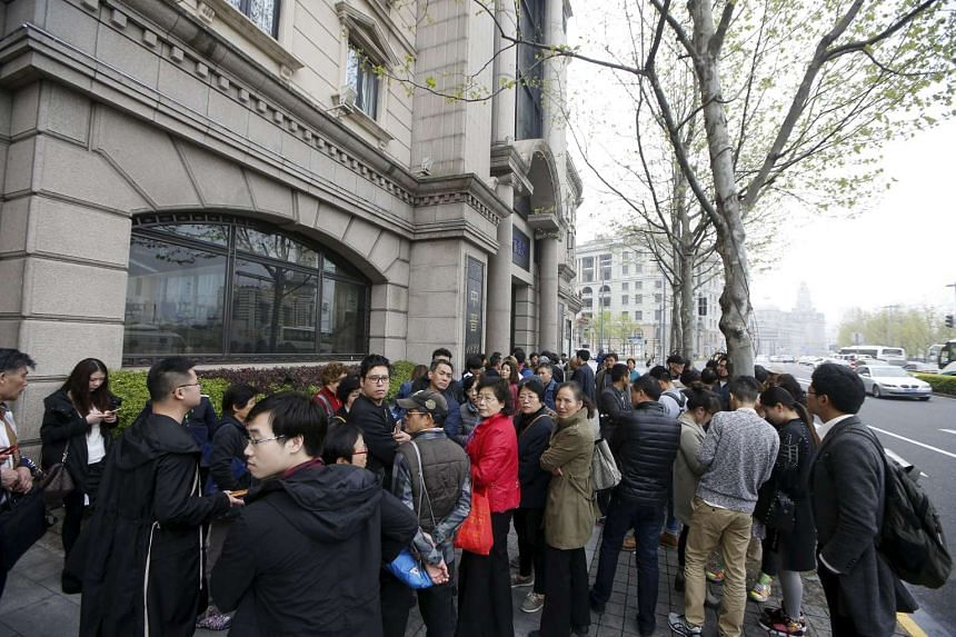 Investors gather at the office of Shanghai investment firm Zhongjin Capital Management in Shanghai, China, on April 7, 2016.