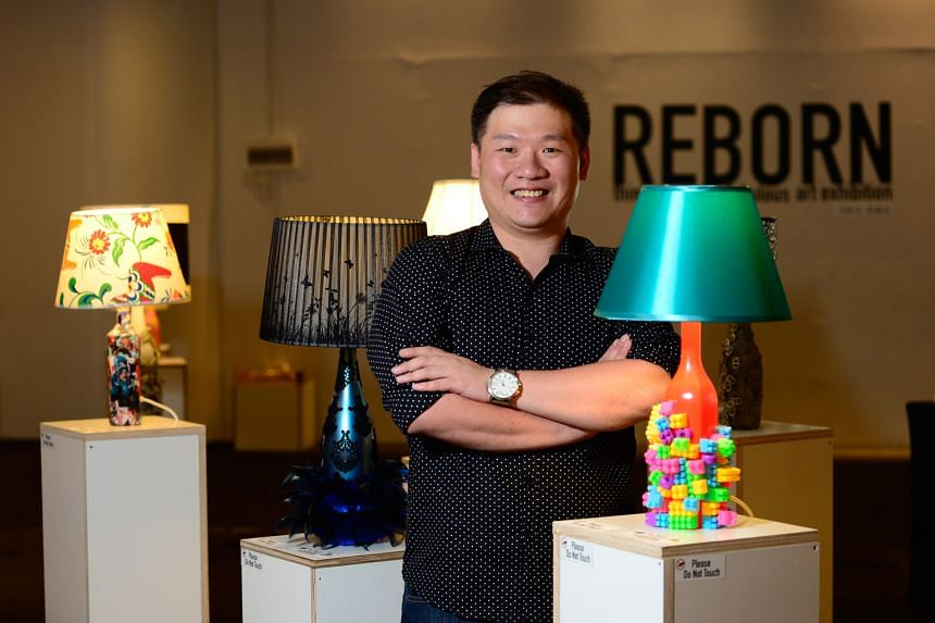 Mr Yeoh with some of his handcrafted lamps on display at the Reborn: Think Green It's Fabulous art exhibition in Capitol Piazza. He hopes that the exhibition will spread awareness about recycling and motivate people to do the same.