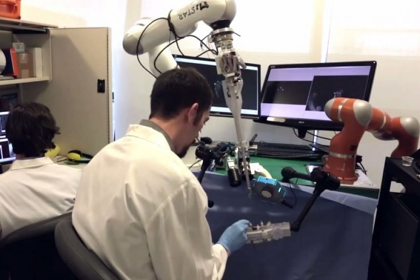 The Smart Tissue Autonomous Robot (seen here in a screenshot from a report on YouTube) acts as a tool to improve the accuracy of stitching.