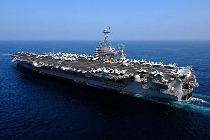The Nimitz-class aircraft carrier USS John C. Stennis conducts operations in the Gulf.