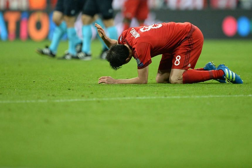 Bayern Munich's Javier Martinez reacts after the Uefa Champions League semi-final second leg football match against Atletico Madrid, on May 3, 2016.