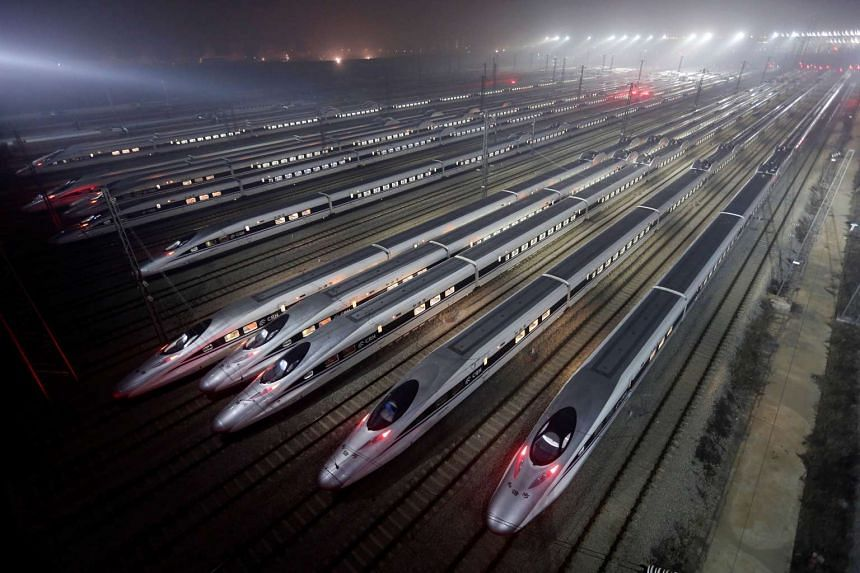 China Railway high-speed Harmony bullet trains at a high-speed train maintenance base in Wuhan, Hubei province.