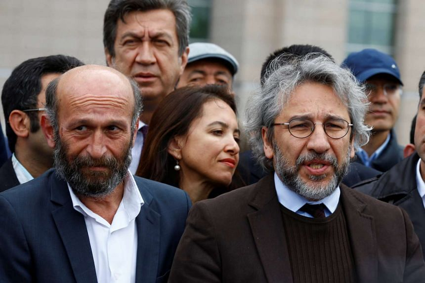 Can Dundar (right), editor-in-chief of Cumhuriyet, with his Ankara bureau chief Erdem Gul arrive at the Justice Palace in Istanbul, on May 6, 2016.