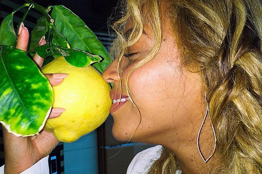 Beyonce (left) posted photos that hinted at the album Lemonade months before she released it.