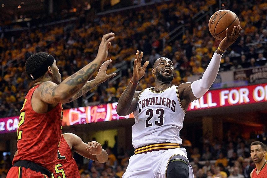 Cavaliers forward LeBron James (right) driving to the basket against Atlanta on Wednesday. The Cleveland star believes his team are more than just a threat from behind the arc.