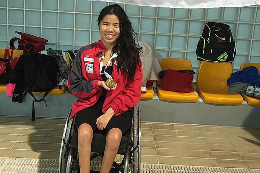 Yip Pin Xiu with her 100m backstroke (S2) gold medal at the IPC Swimming European Open Championships in Funchal, Portugal, yesterday. Her winning time of 2min 9.79sec was more than six seconds faster than the previous mark.