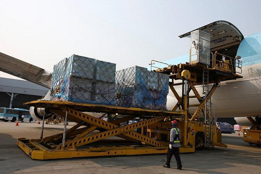 """Cargo being unloaded from a Korean Air Lines freight plane. Asia-Pacific carriers reported a 5.2 per cent year-on-year drop in volume for March. Iata chief executive Tony Tyler said: """"It's shaping up to be another tough year for air cargo."""""""