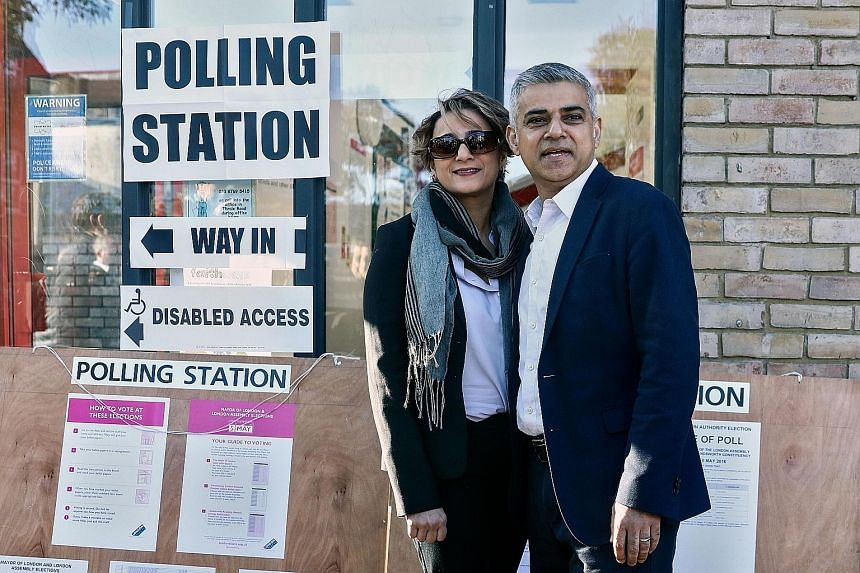 Mr Sadiq Khan, the Labour Party candidate for London mayor, and his wife Saadiya Khan after casting their votes yesterday.