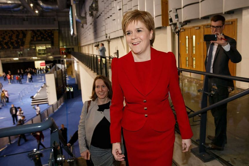 Leader of the Scottish National Party (SNP), Nicola Sturgeon reacts after a positive result for her party at the Emirates Arena in Glasgow, on May 6, 2016.