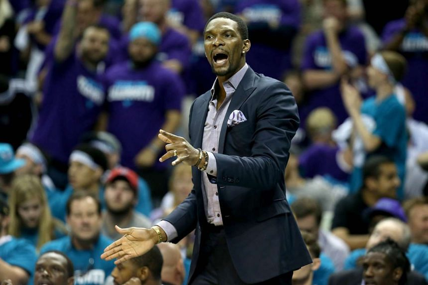 Chris Bosh #1 of the Miami Heat watches on from the bench against the Charlotte Hornets during game four of the Eastern Conference Quarterfinals of the 2016 NBA Playoffs on April 25, 2016.