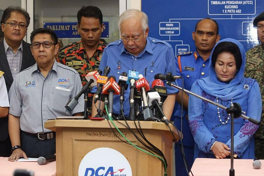 Prime Minister Najib Razak at a press conference where reporters have gathered for the briefing at Kuching airport.