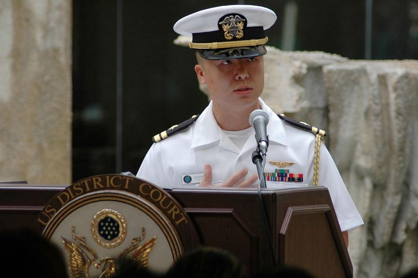 Lieutenant Commander Edward Lin, a native of Taiwan, speaks about his path to American citizenship at a ceremony in Honolulu, Hawaii, in this US Navy handout photo taken Dec 3, 2008.