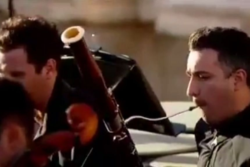 A screenshot from an online report of the orchestra playing in Palmyra.