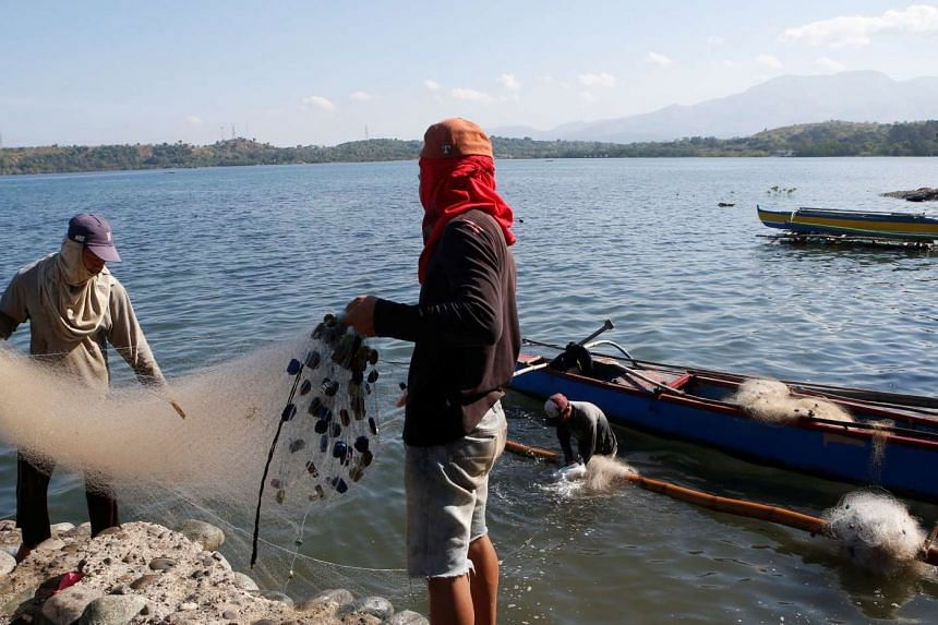 Fishermen are pictured in Masinloc, Zambales in the Philippines, on April 22, 2015.