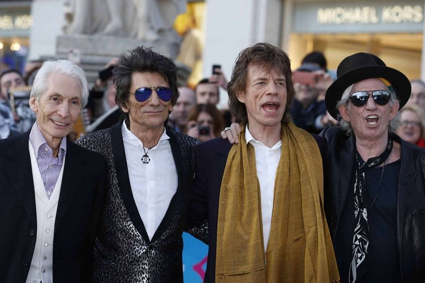 Members of the Rolling Stones (from left) Charlie Watts, Ronnie Wood, Mick Jagger and Keith Richards arrive for the Exhibitionism opening night gala in London, Britain, on April 4, 2016.