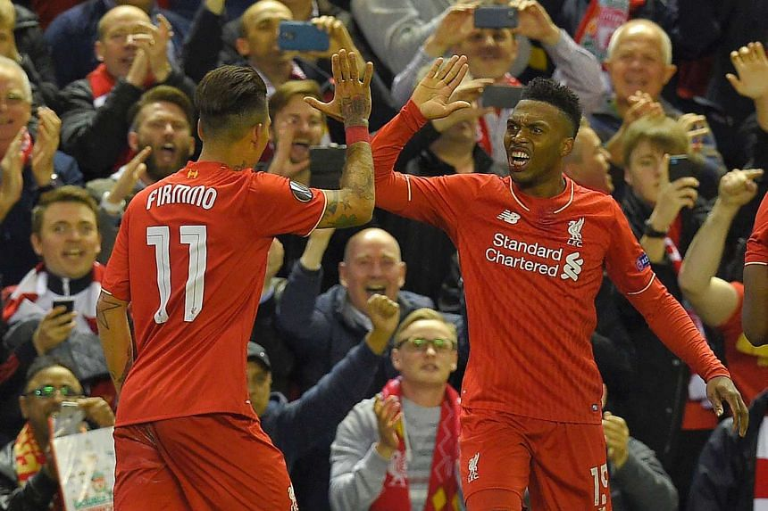 Sturridge (right) celebrates after scoring his team's second goal.