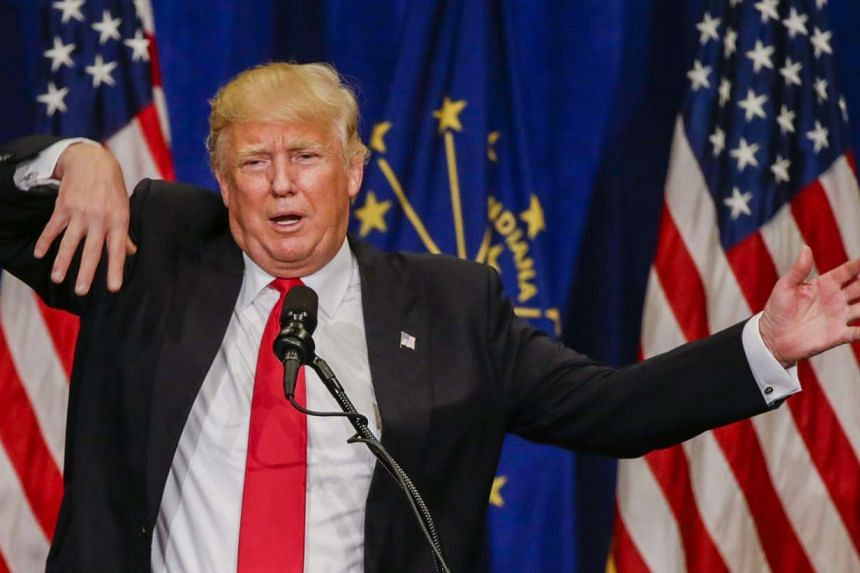 Trump gestures as he speaks at a campaign rally on May 2, 2016.