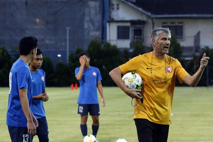 Garena Young Lions coach Patrick Hesse (in yellow) at a training session.