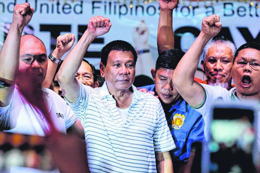 Filipino presidential candidate, Rodrigo Duterte (centre), gestures during an election campaign rally in Quezon city, Philippines, on April 23, 2016.