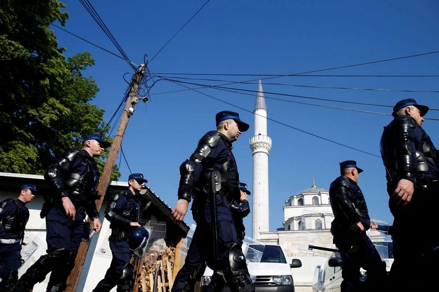 Members of a special police unit take up positions in front of the Ferhat-Pasha mosque before an opening ceremony, on May 7, 2016.