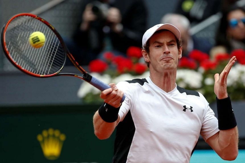 Andy Murray returns the ball in a match against Rafael Nadal in the Madrid Open, on May 7, 2016.