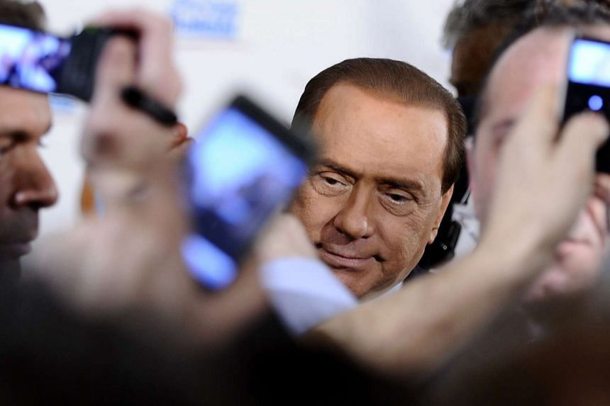 Former Italian Prime Minister Silvio Berlusconi's family company is likely to open exclusive talks with Chinese investors interested in buying AC Milan.