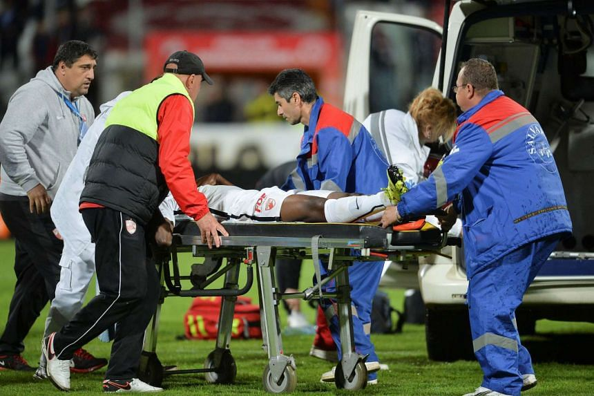 Dinamo Bucharest's Patrick Ekeng is transported to an ambulance after collapsing at a play-off match against Viitorul Constanta in Bucharest, on May 6, 2016.