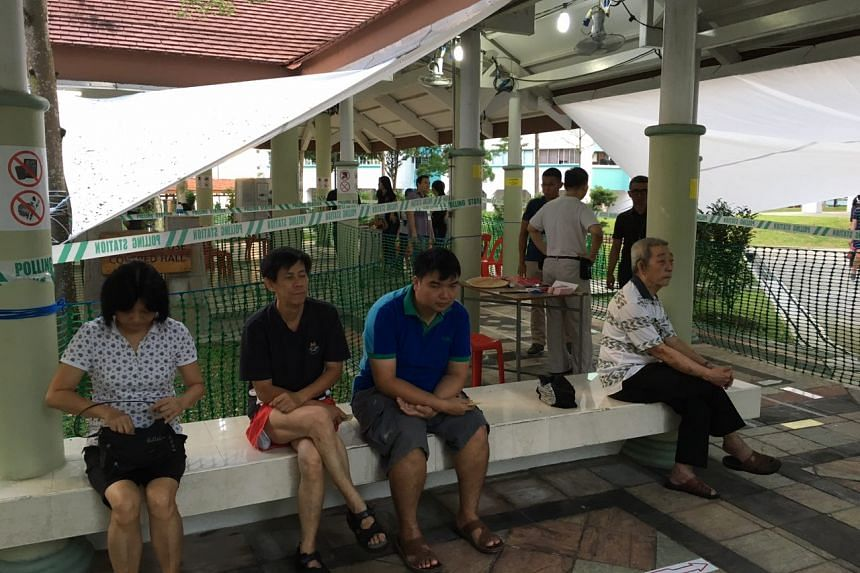 First batch of voters waiting at the voting station at Block 105A, Bukit Batok Central, on Saturday morning.