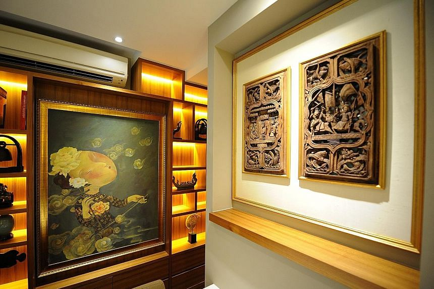 A painting by Chinese artist Liu Jianhua and a wood carving (both above) from Anhui province in China.