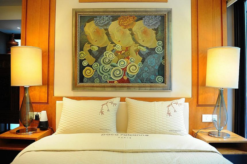 Another painting by artist Liu Jianhua (above) takes pride of place above the bed. The bedroom is modelled on the rooms at Four Seasons Hotel in Guangzhou.