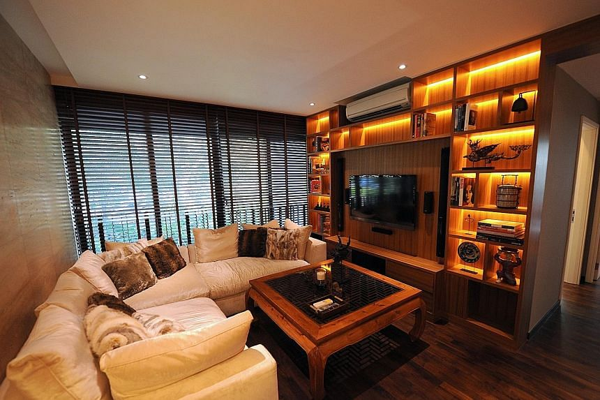 The custom-built teak coffee table in the living room frames a Chinese wood window carving.