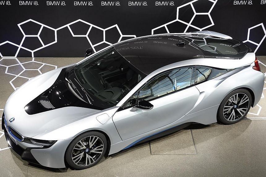 BMW is developing a roadster version of its hybrid i8 supercar (above).