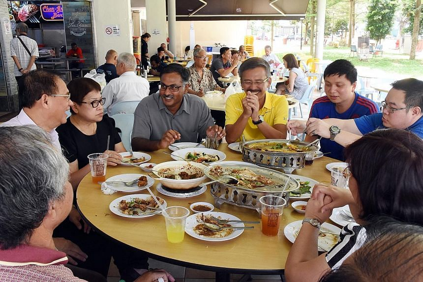 Dr Chee (second from left), having a picnic with Singapore Democratic Party members and volunteers at the Botanic Gardens yesterday afternoon. He spent the rest of the day with his family, said a party spokesman. Mr Murali (third from left) having lu
