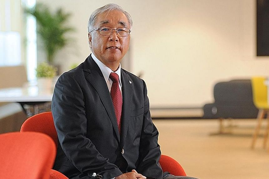 Canon Singapore president and chief executive Kensaku Konishi says switching to a portable medical benefits scheme for staff will incur costs in the transition period but, in the long run, the scheme will help to stabilise insurance costs for the fir