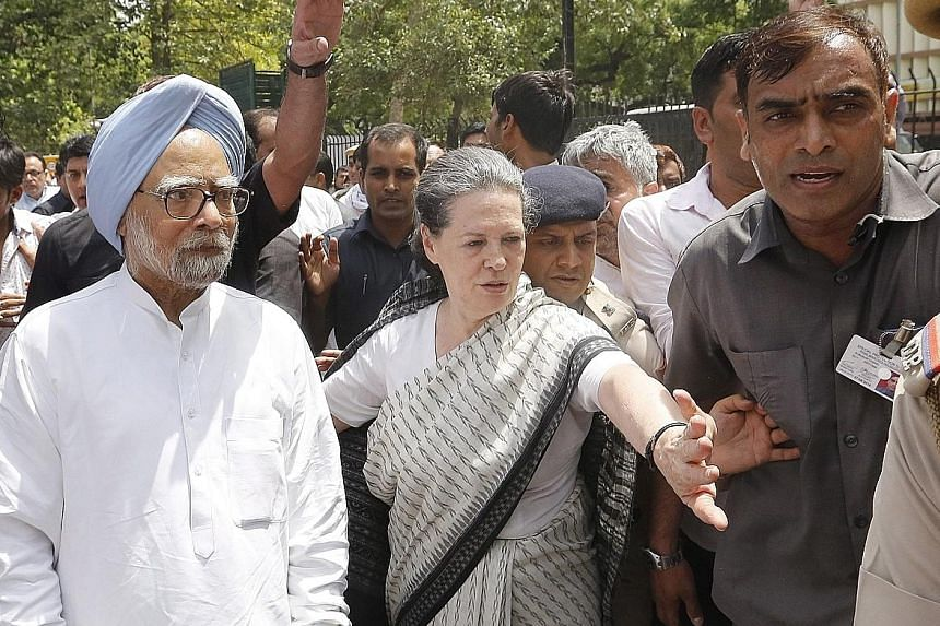 Congress party president Sonia Gandhi and former Indian prime minister Manmohan Singh (far left) leading the Save Democracy March in New Delhi yesterday.