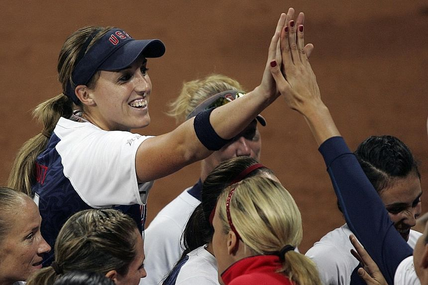Monica Abbott celebrates after pitching a no-hitter at the 2008 Olympics. The 30-year-old American's fastball reaches 123kmh. She is the first woman in US team sport to sign a contract worth US$1 million.