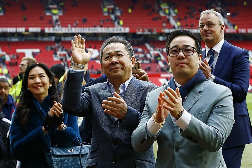 Leicester City's Thai owner Vichai Srivaddhanaprabha (centre) and his son Aiyawatt (right) acknowledging the club's fans at Old Trafford earlier this month.