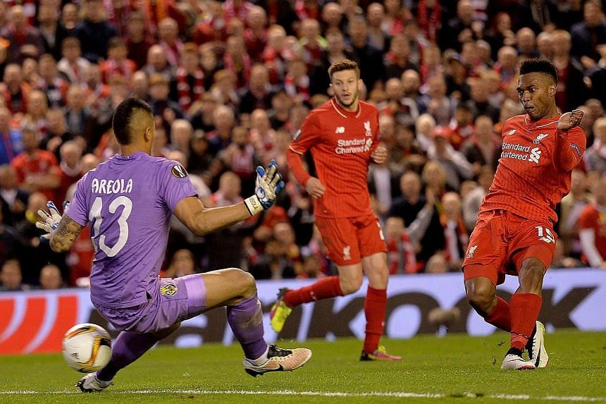 Liverpool's Daniel Sturridge slotting home the decisive second goal against Villarreal on Thursday. The Reds claimed a 3-1 aggregate Europa League semi-final win that put them in their second final under Juergen Klopp.