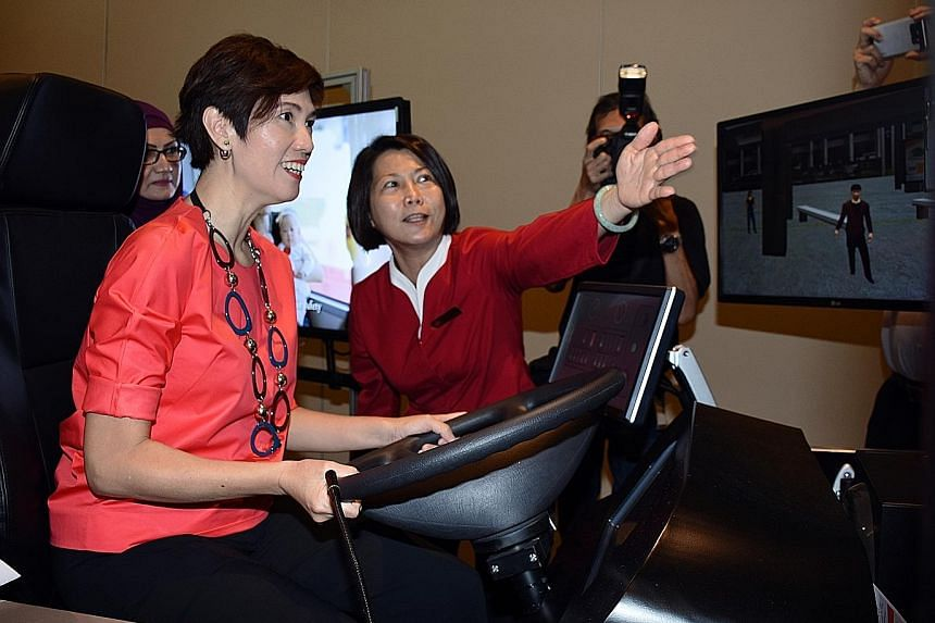 Senior Minister of State for Transport Josephine Teo trying out a bus simulator at the event yesterday. The Government announced plans to ramp up the pool and quality of bus captains under an extensive manpower plan.