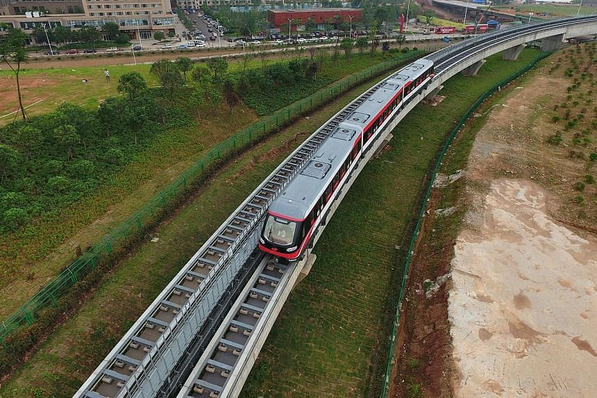 The magnetic levitation train, with a maximum speed of 100kmh, began ferrying passengers on the 18.5km-long line in the city of Changsha yesterday.